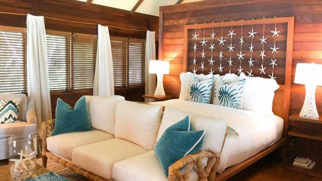 King size bed and lounge area in one of the villas – Cuvee