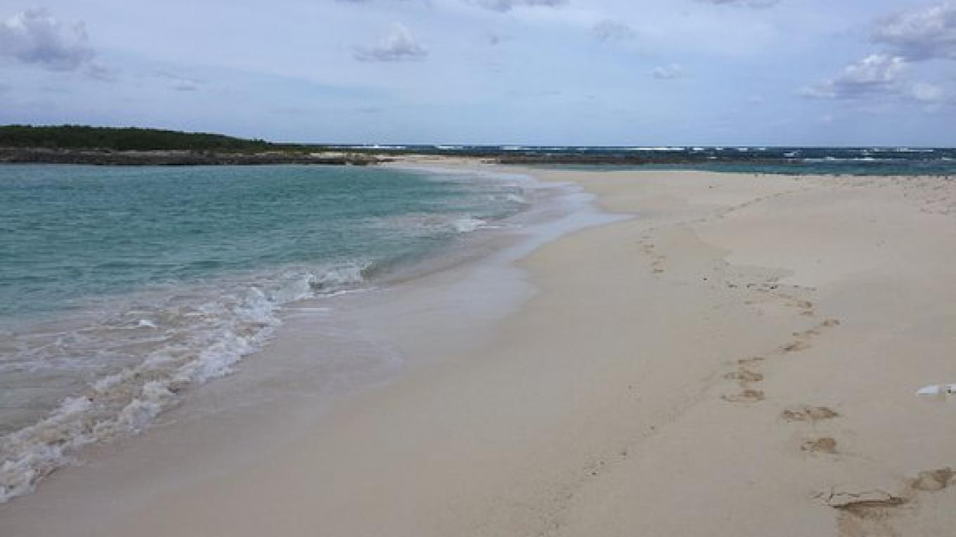 View of the sandy beach and the turquoise waters at Twin Cove Beach – tripadvisor