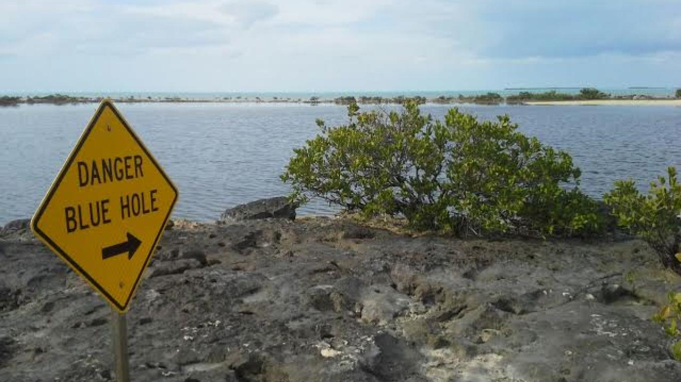 Chub Cay Blue Hole Danger Sign – Kevin Wallace, Berry Islands Tourism Representative