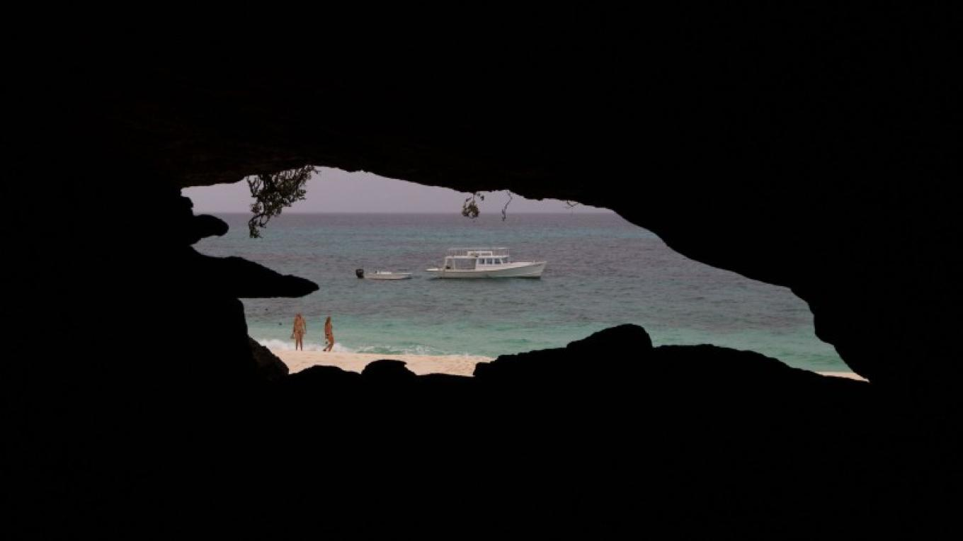 View of the beach and water from inside Hartford Cave – Bahamas Ministry of Tourism