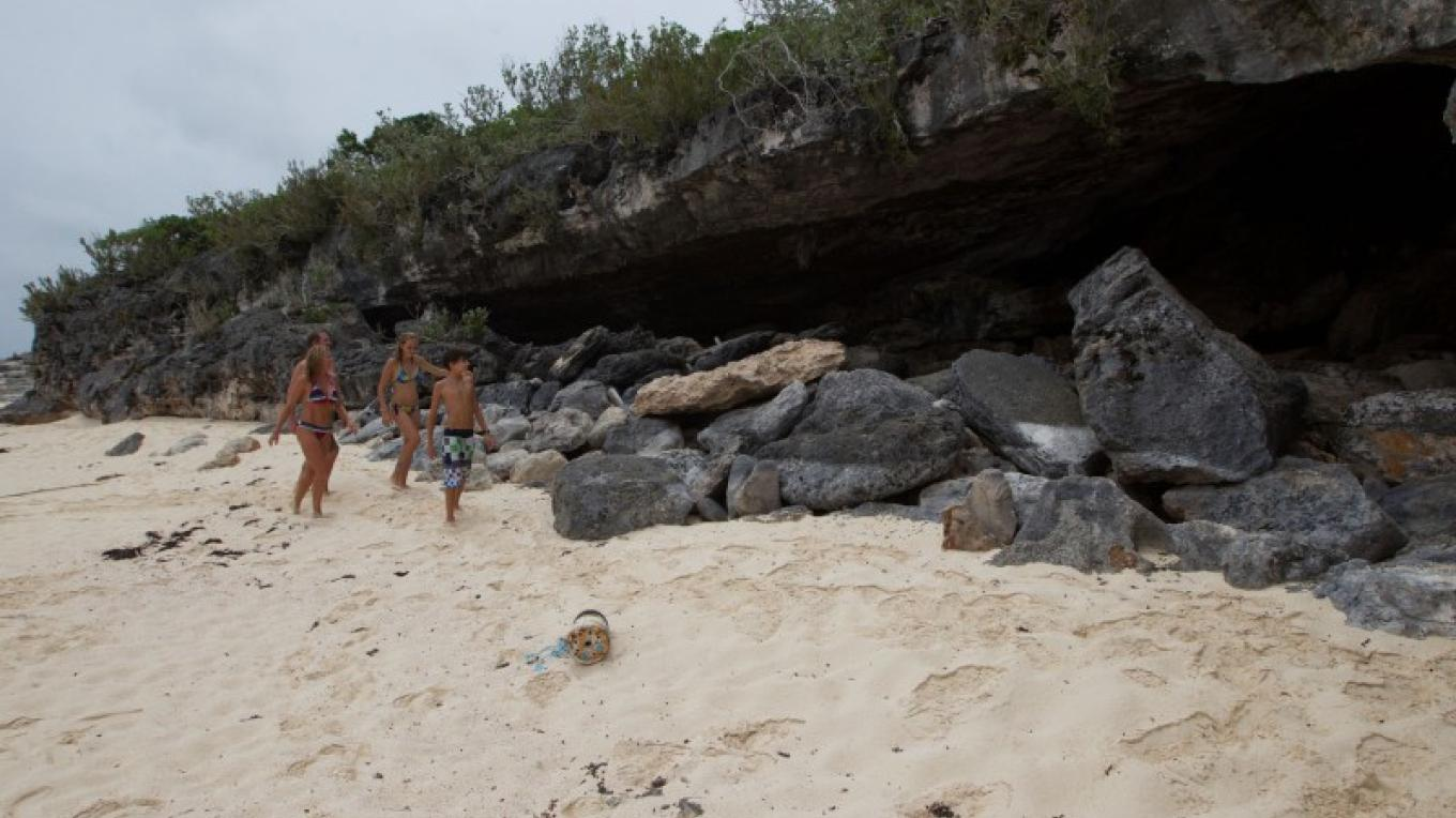 People entering Hartford Cave from the beach – Bahamas Ministry of Tourism