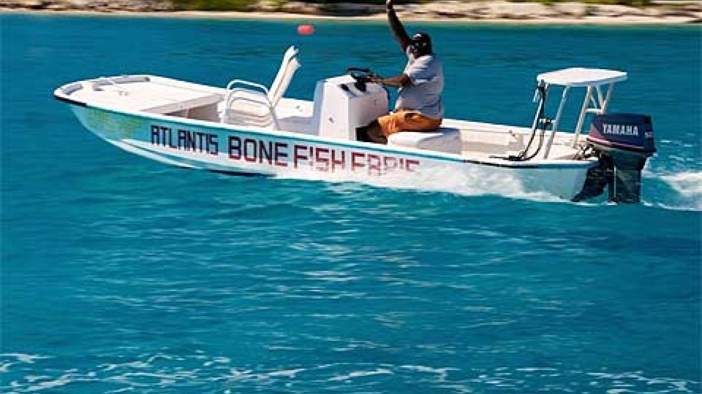Bonefish Ebbie riding in his Boat 'Atlantis' – Bimini Big Game club Resort and Marina