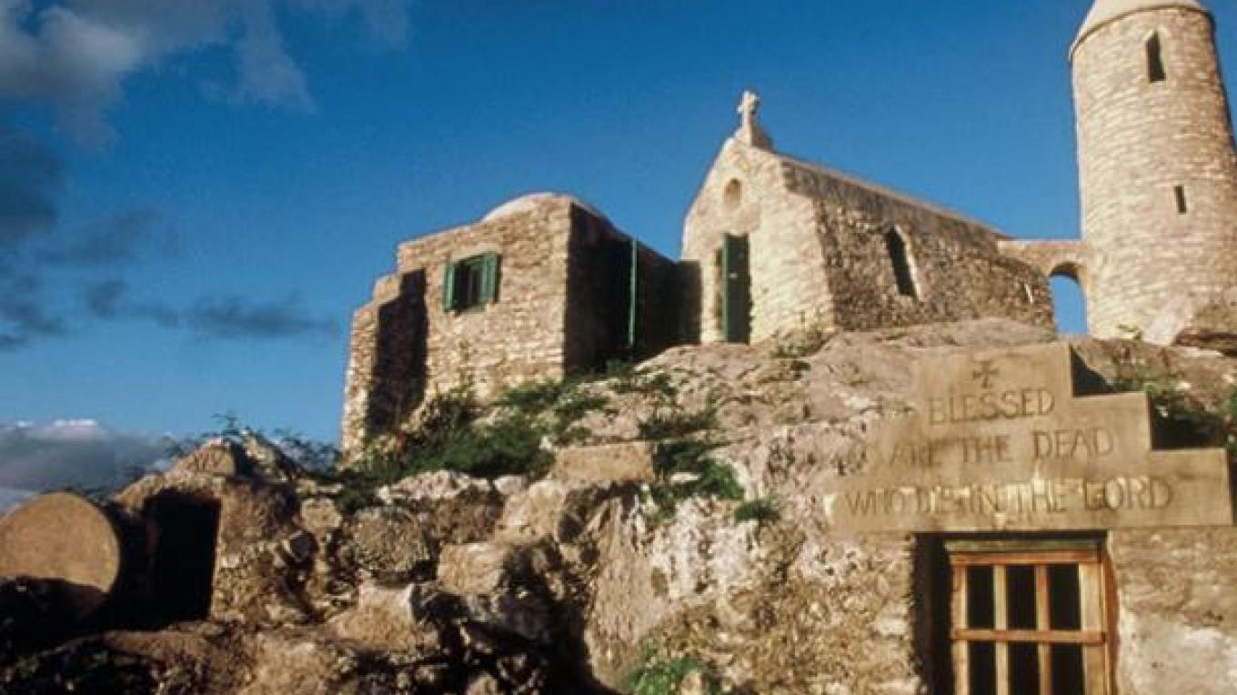 View of The Hermitage showing a religious message carved into the stone by Father Jerome. – Bahamas Ministry of Tourism