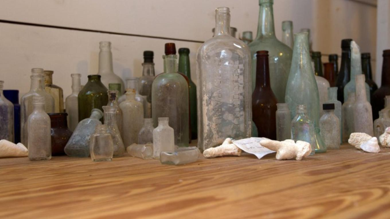 Old bottles inside the Wyannie Malone Historical Museum – Bahamas Ministry of Tourism