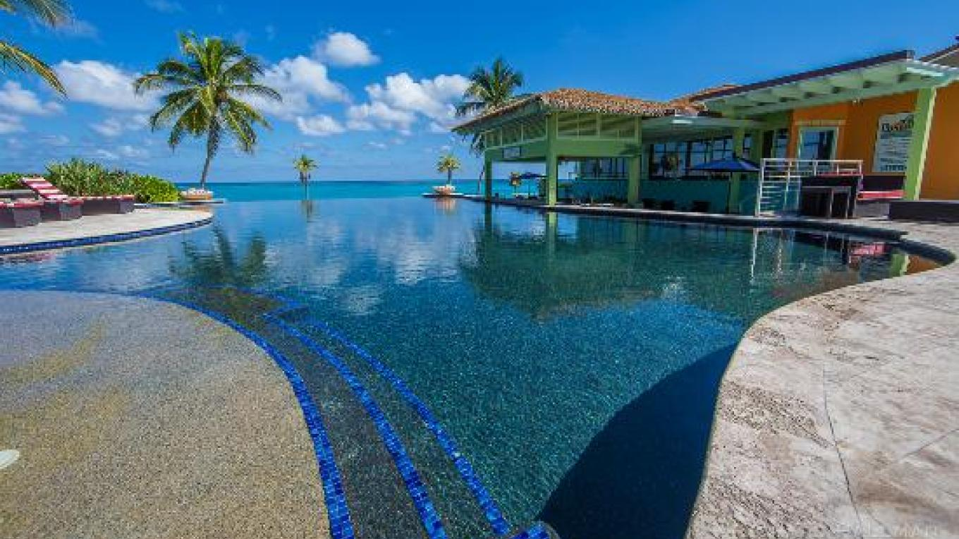 View of the pool area adjacent to Pascal's Ocean Front – tripadvisor