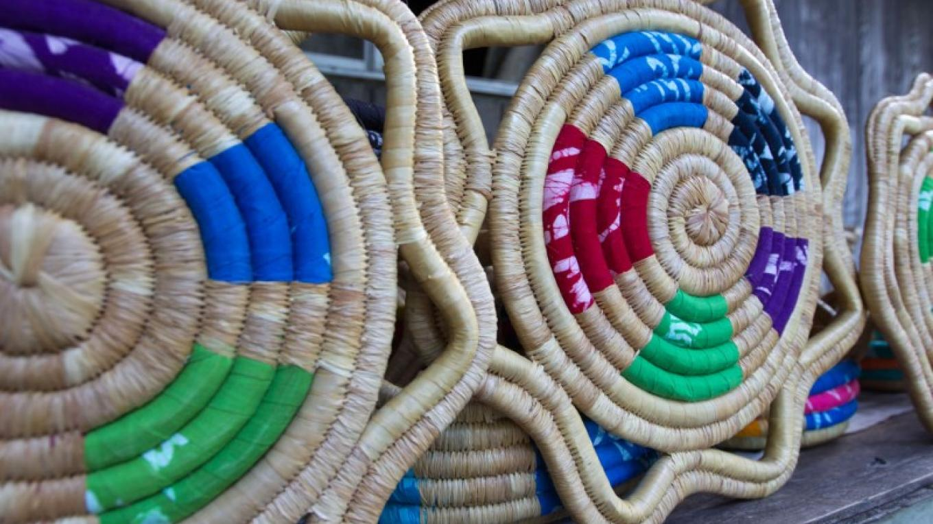 Woven craft that includes Androsia pieces – Bahamas Ministry of Tourism