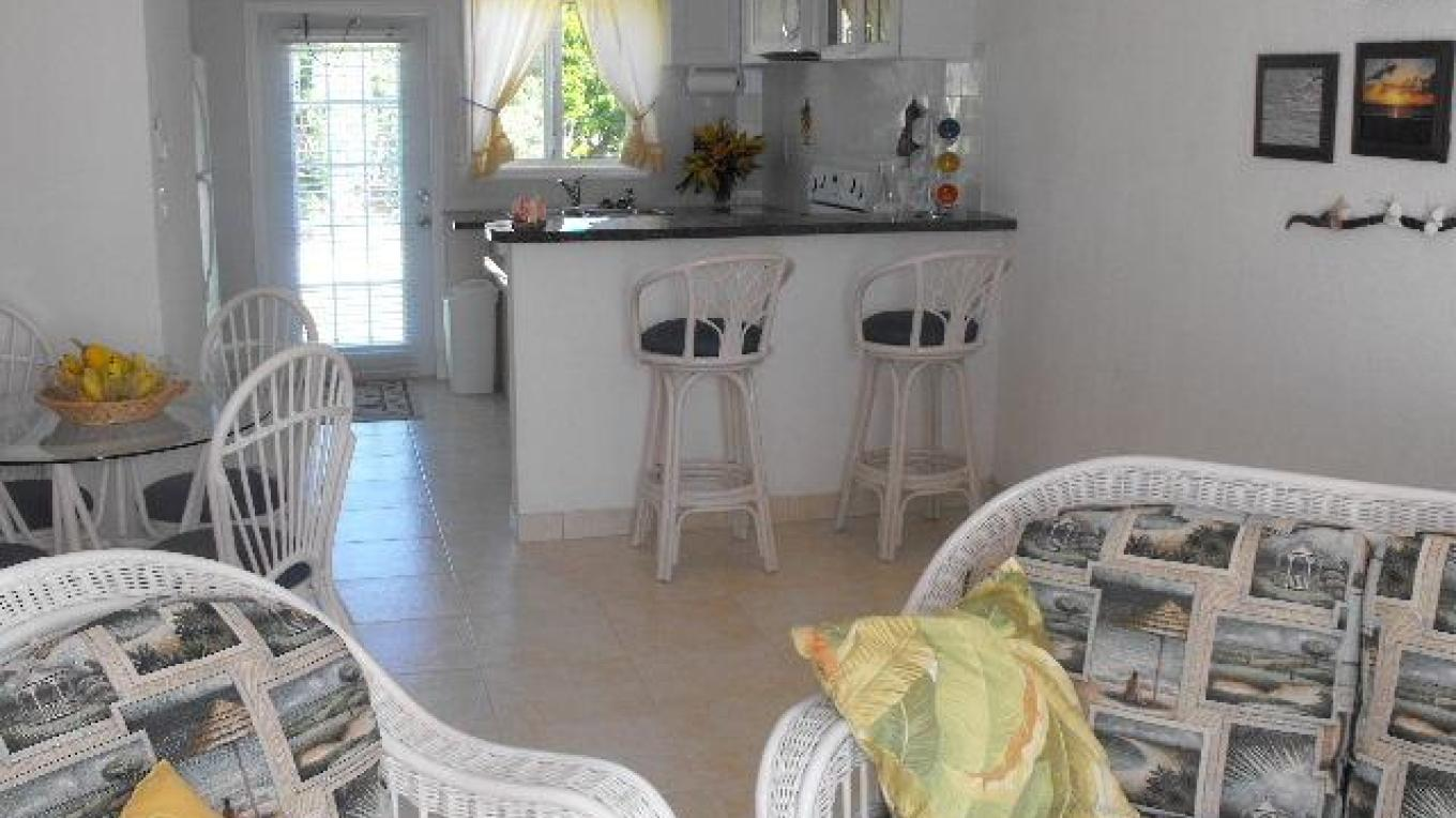 The kitchen and living room area in on of the villas – tripadvisor