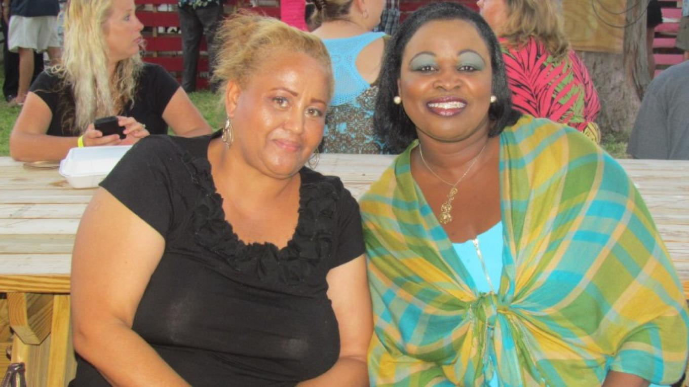 Ministry of Tourism Rep (R) with Guest – Franklyn & Lydia Burrows