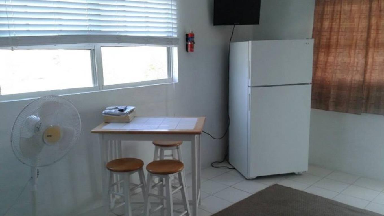 Kitchen/dining area at BrensVille Suites – BrensVille Suites
