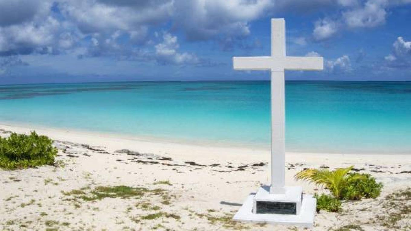 The beach at Long Bay with the white cross. – Alex Mustard