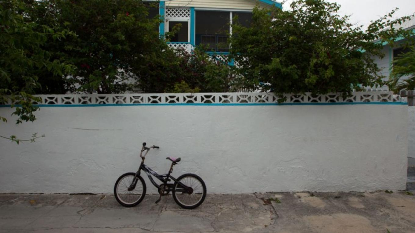 House with a parked bicycle, one of the main forms of transportation here. – Bahamas Ministry of Tourism