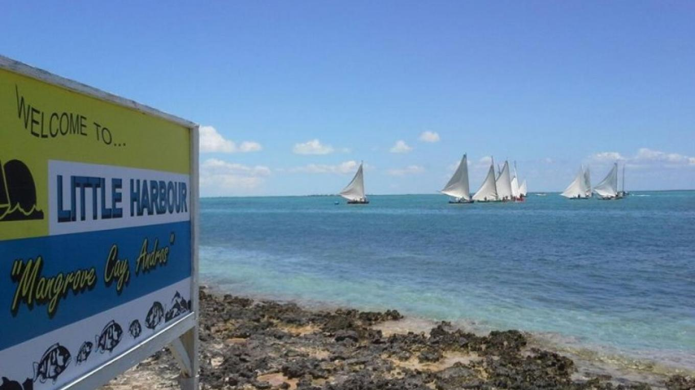 Photo on the beach of boats sailing. – Ministry of Tourism