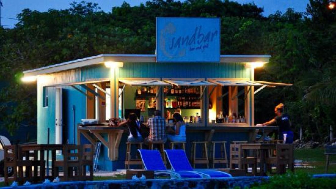 Night view of patrons at the Sandbar – tripadvisor