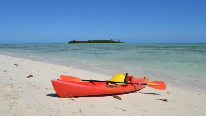 Photo of Kayak on beach. – Swain's Cay Lodge