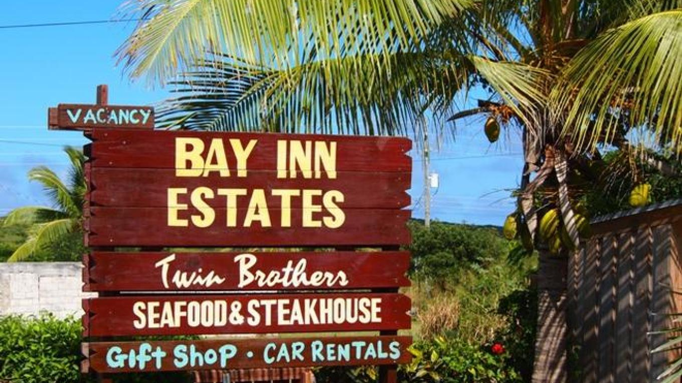 Sign for Bay Inn Estates &Twin Brothers – Bay Inn Estates