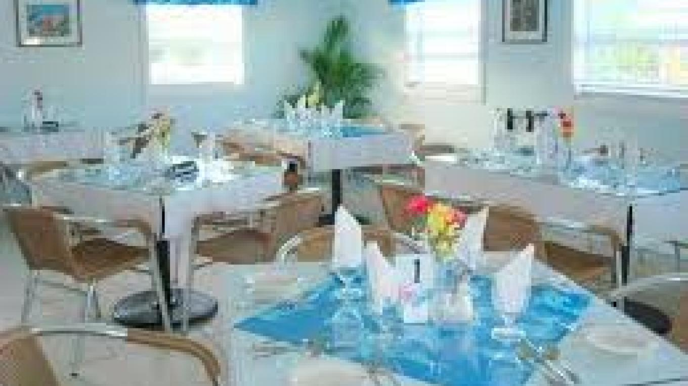 Inside the restaurant at Miss Emily's Blue Bee Bar – Abaco Tourist Office