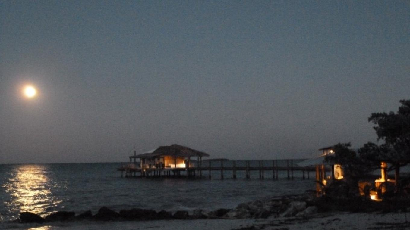 Dive Center and Bar with a full Moon – Small Hope Bay Lodge