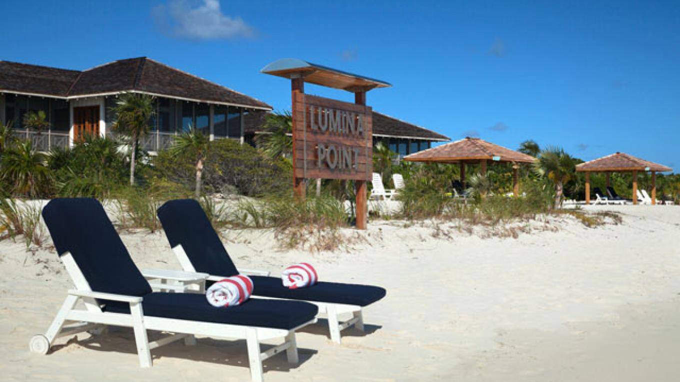 Lounge Chairs on the beach at Lumina Point Resort & Spa – Lumina Point Resort & Spa