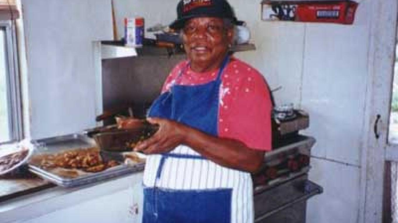 "Mrs. Florence ""Flo"" Dean in the kitchen. – Berry Islands Tourism Representative"