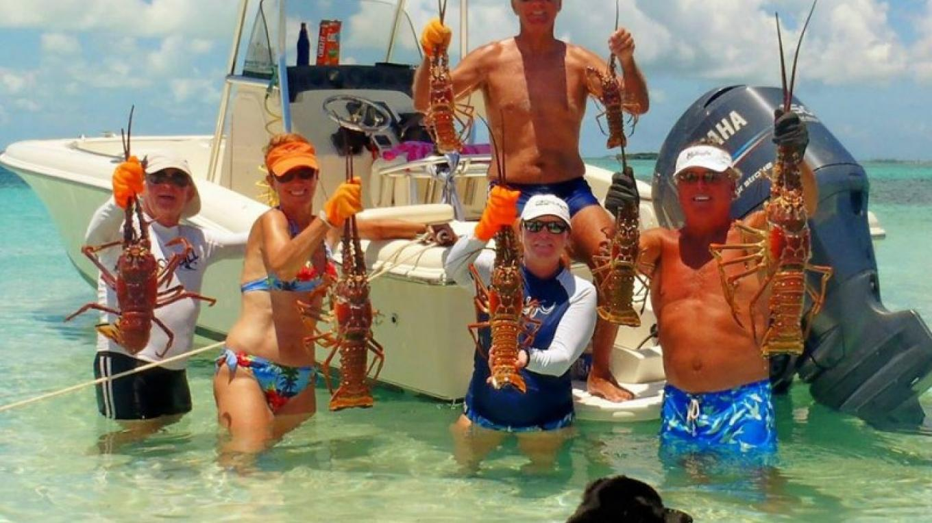 Lobster Fest participants show off their catch. – Berry Islands Tourism Representative