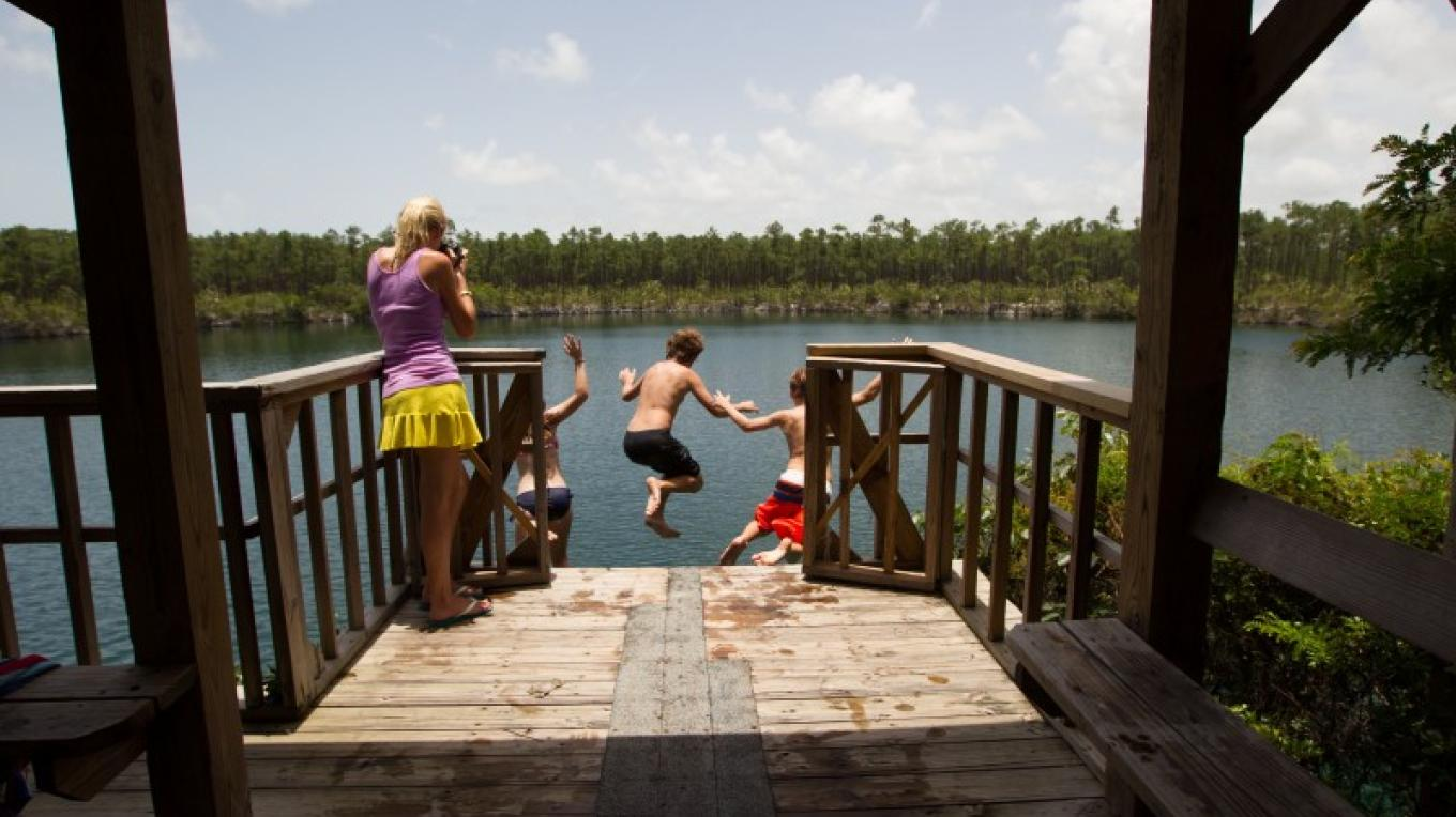 Children jumping into Uncle Charlie's Blue Hole – Bahamas Ministry of Tourism