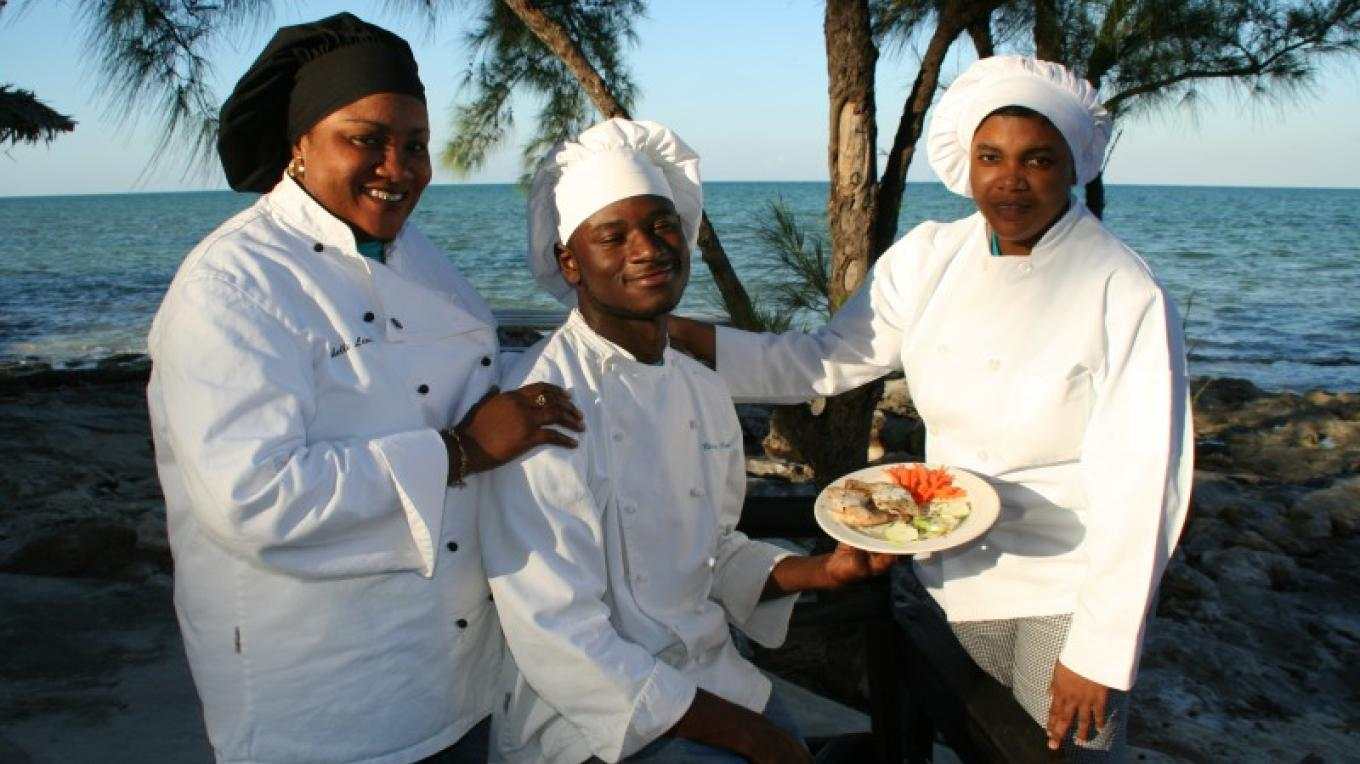 Chefs ate the outside Dinning Terrace – Small Hope Bay Lodge