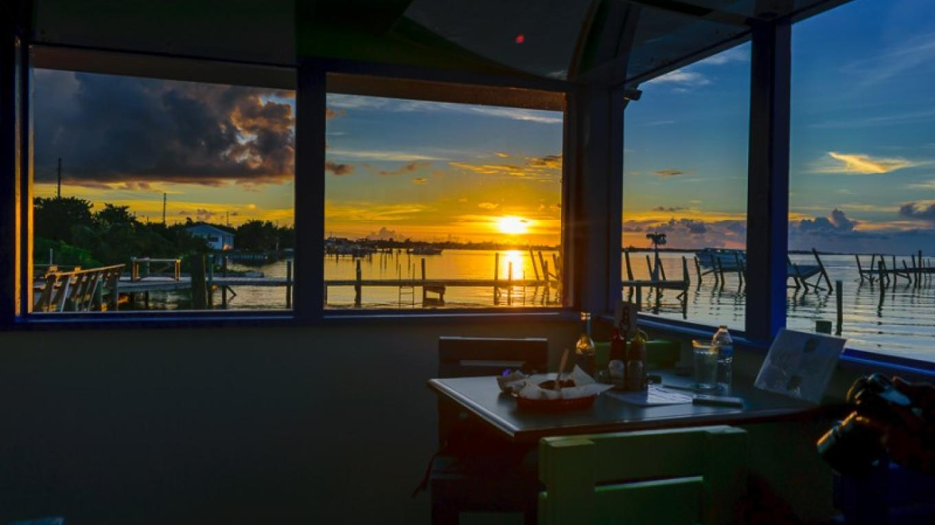 Sunset at Colors by the Sea Restaurant & Bar, located on the Tourist Strip in Marsh Harbour – Bahamas Ministry of Tourism