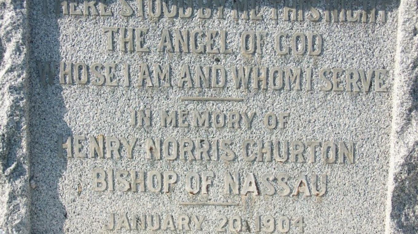 The plaque at the bottom of the Pigeon Cay Cross.