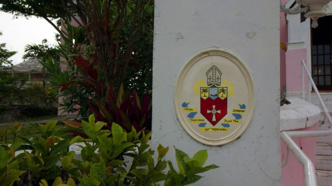 Plaque on left side of front entrance at St. John's Anglican Church – Bahamas Ministry of Tourism