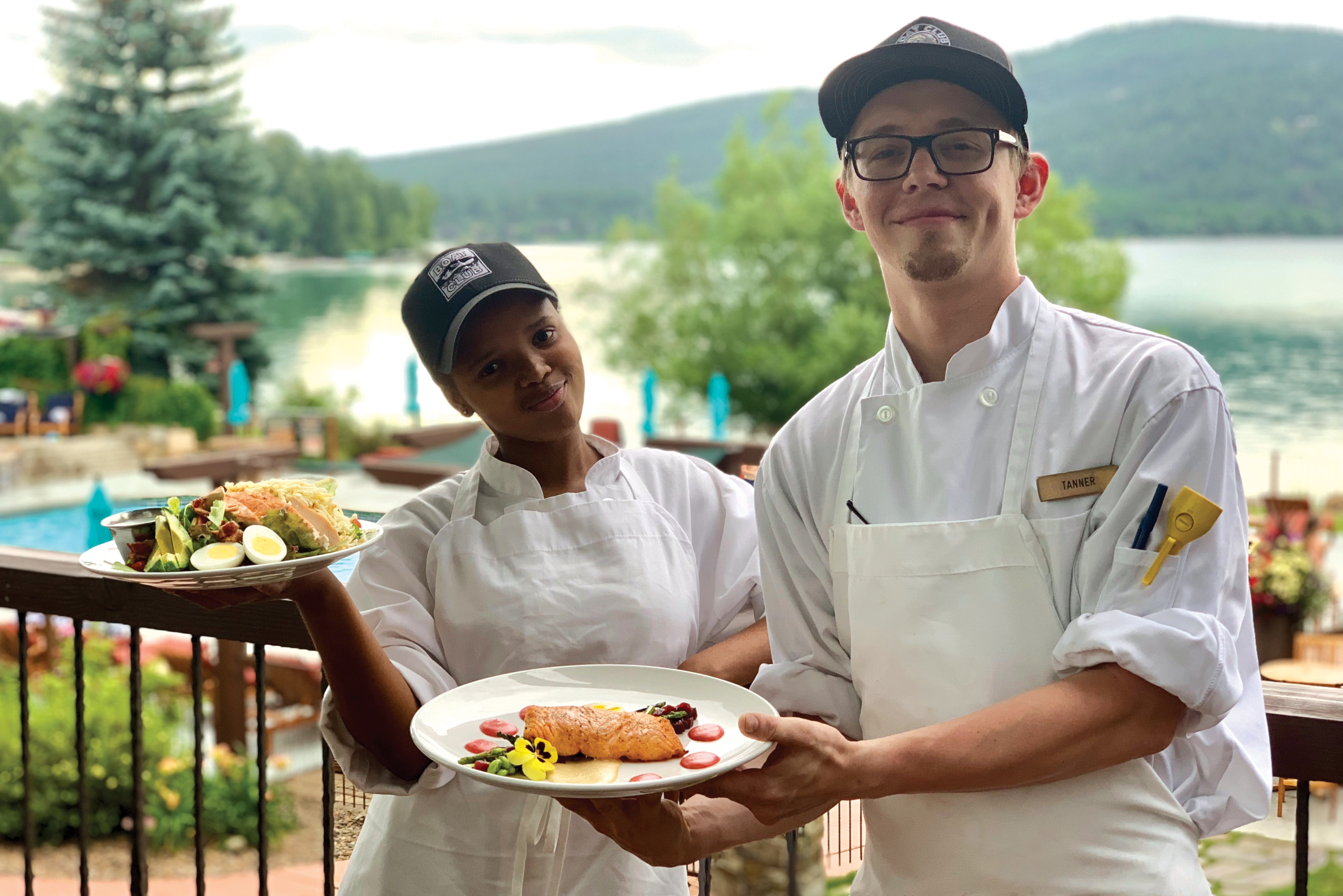 Showing off their culinary creations on the deck overlooking Whitefish Lake.