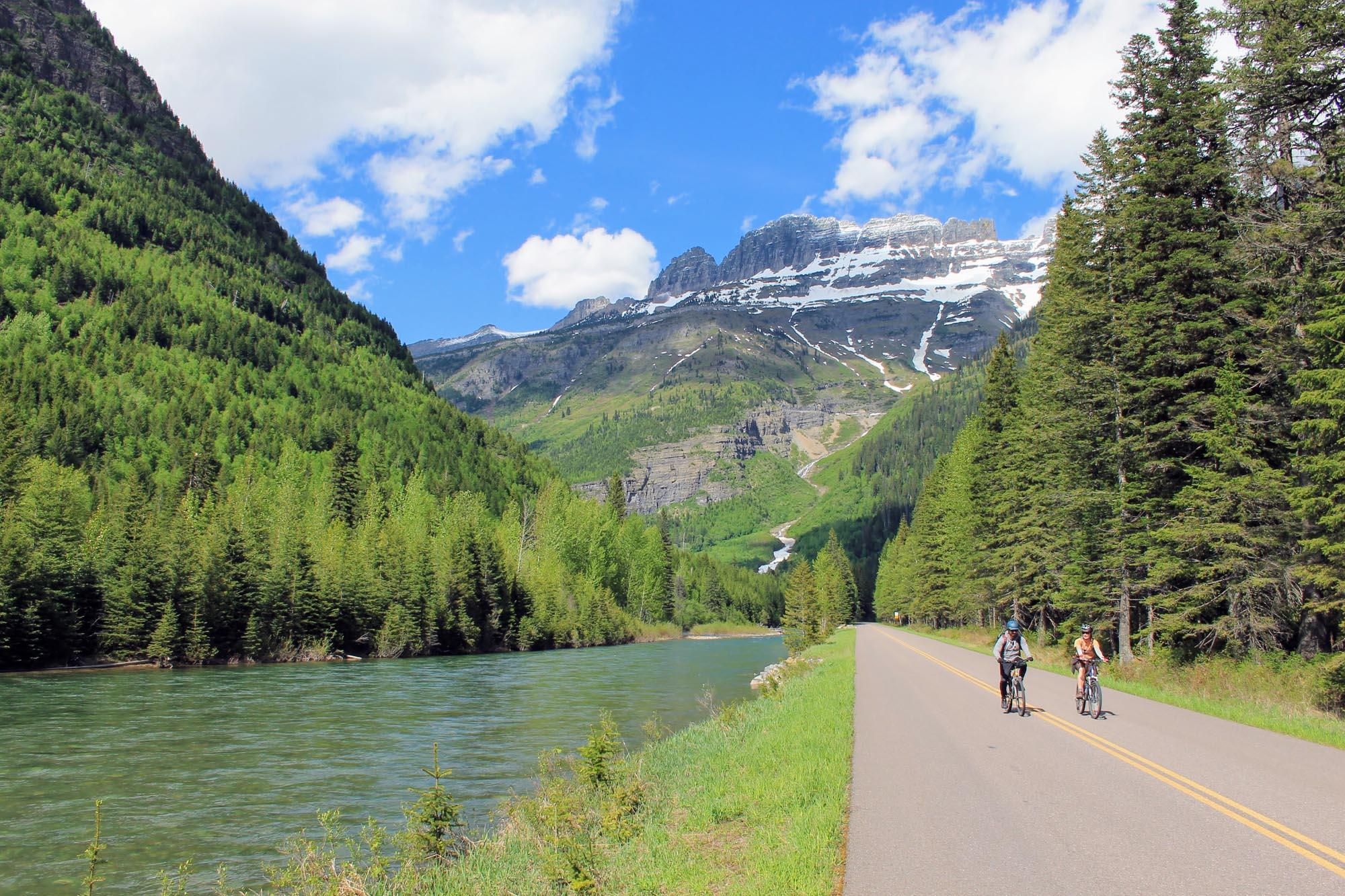 Biking along the flat lower sections of Going-to-the-Sun Road