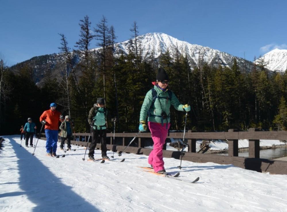 Crossing McDonald Creek on a midday ski tour. – Devin Schmit