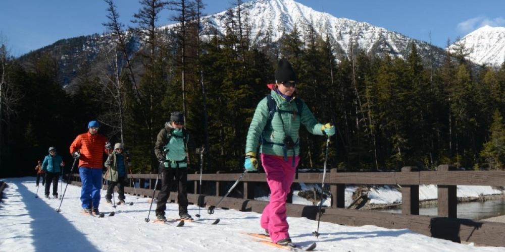 Crossing McDonald Creek on a midday ski tour. – Devin Schmit