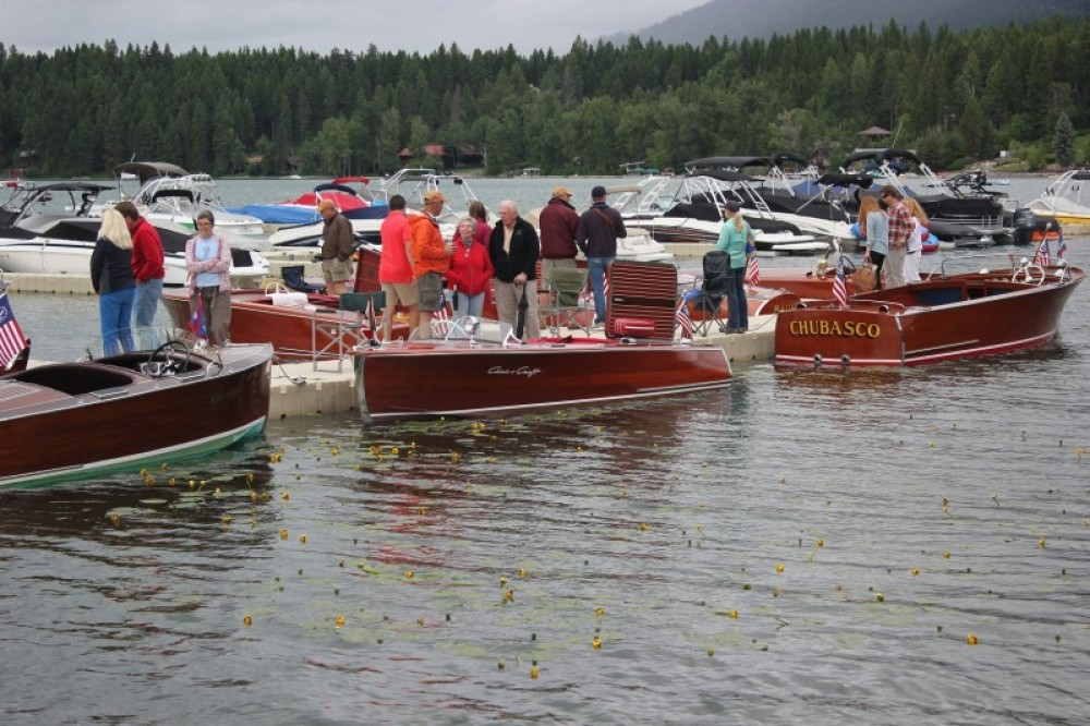 """Saturday boat show dock-walkers surveying a 1937, 1941 and 1948 Chris Craft before casting their vote for the """"People's Choice"""" award. – Tim Salt"""
