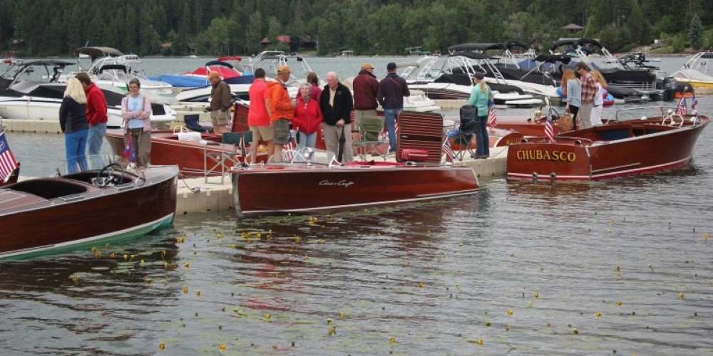 "Saturday boat show dock-walkers surveying a 1937, 1941 and 1948 Chris Craft before casting their vote for the ""People's Choice"" award. – Tim Salt"