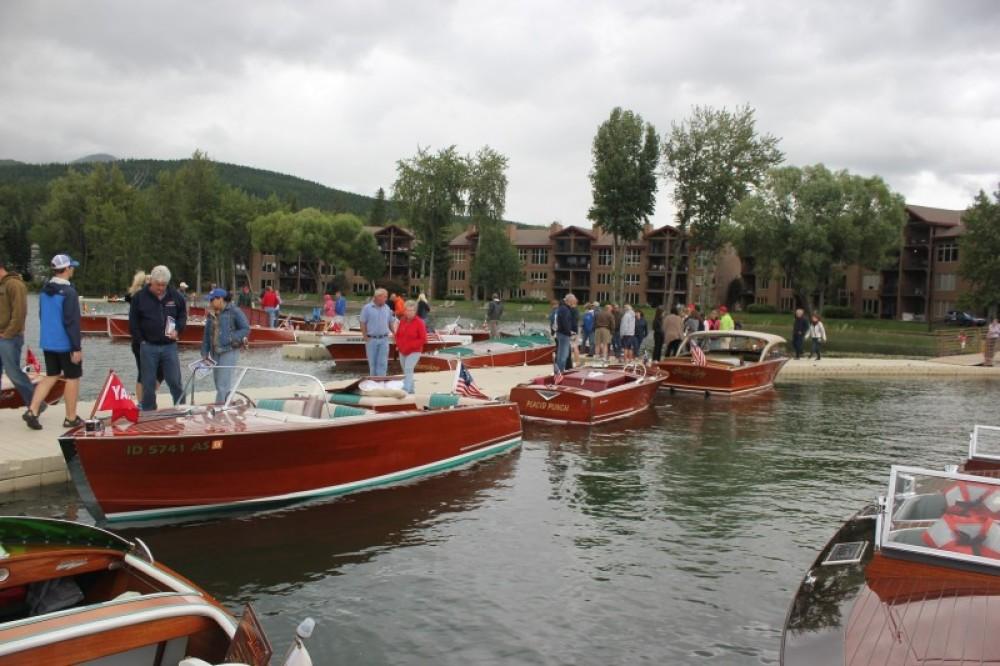 Saturday boat show dock-walkers enjoying a very rare Coeur d'Alene built Yandt boat, a Century and a Chris Craft hardtop. – Tim Salt