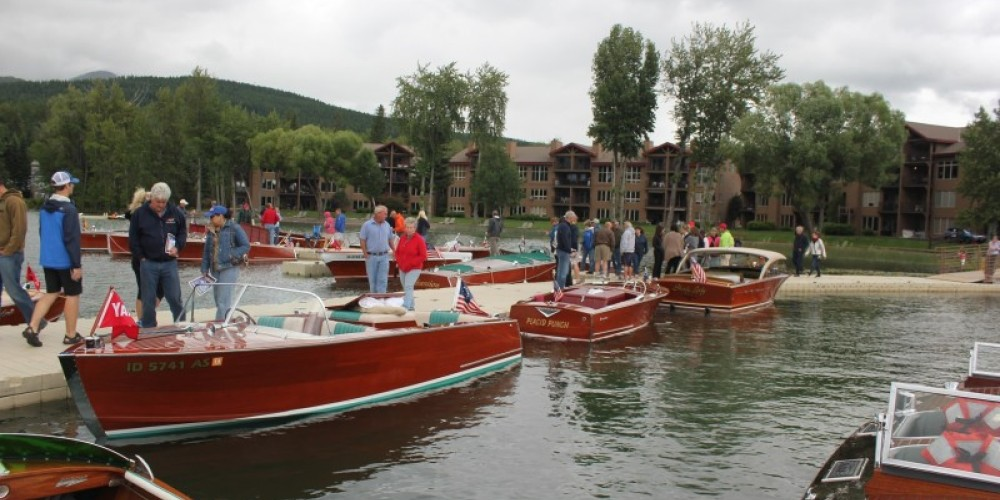 Saturday boat show dock-walkers enjoying a very rare Coeur d'Alene built Yandt boat, a Century and a Chris Craft hardtop. – Tim Salt