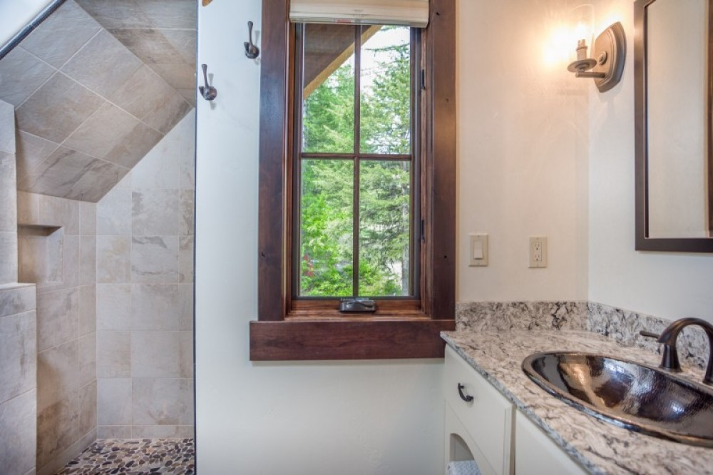 The loft level bath includes a shower and an extra wide single vanity. – Trevon Baker