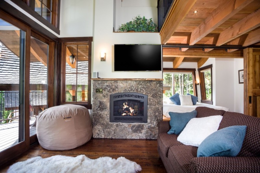 Cozy seating for relaxing by the fireplace and with Netflix or cable on the high definition TV – Trevon Baker