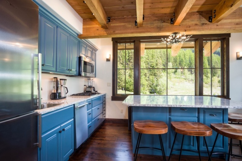 The chef's kitchen has gourmet appliances and great views – Trevon Baker