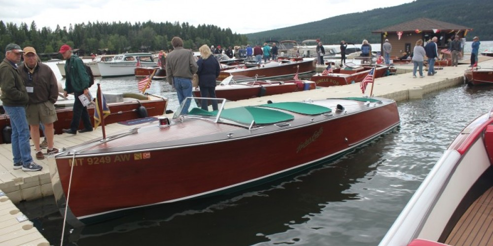 Saturday boat show dock-walkers enjoying the craftsmanship and art of the classic boats. – Tim Salt