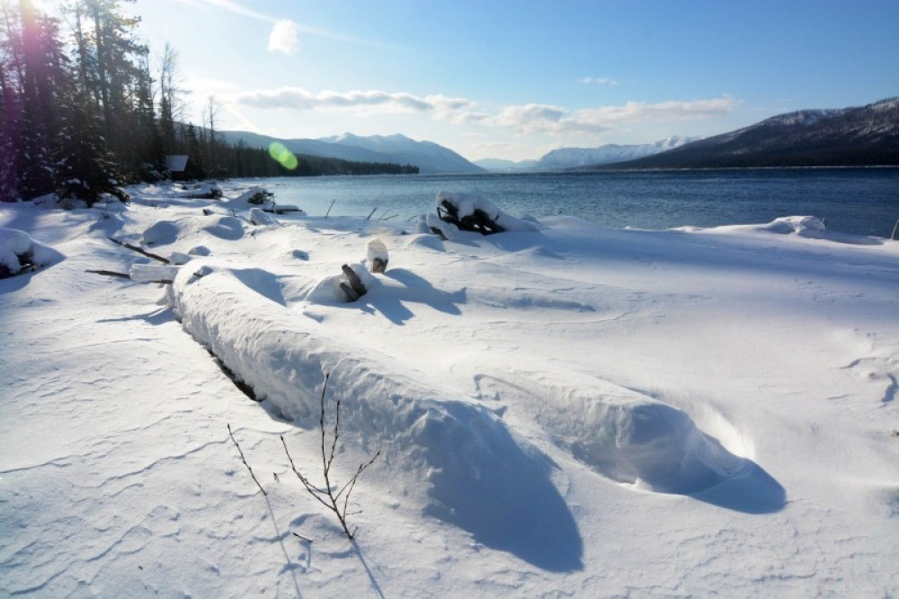 A landscape drifted over on the shores of Lake McDonald. – Devin Schmit