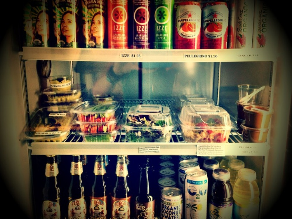 To-Go Cooler Drinks: coconut water, kombucha, yerba mate, ginger ale, izze, pelligrino, rt beer, cream soda, and recharge sport drink. Food: Organic hummus, veggie sticks, salads, sandwiches and chocolate avocado pudding. – Lynon Lohof