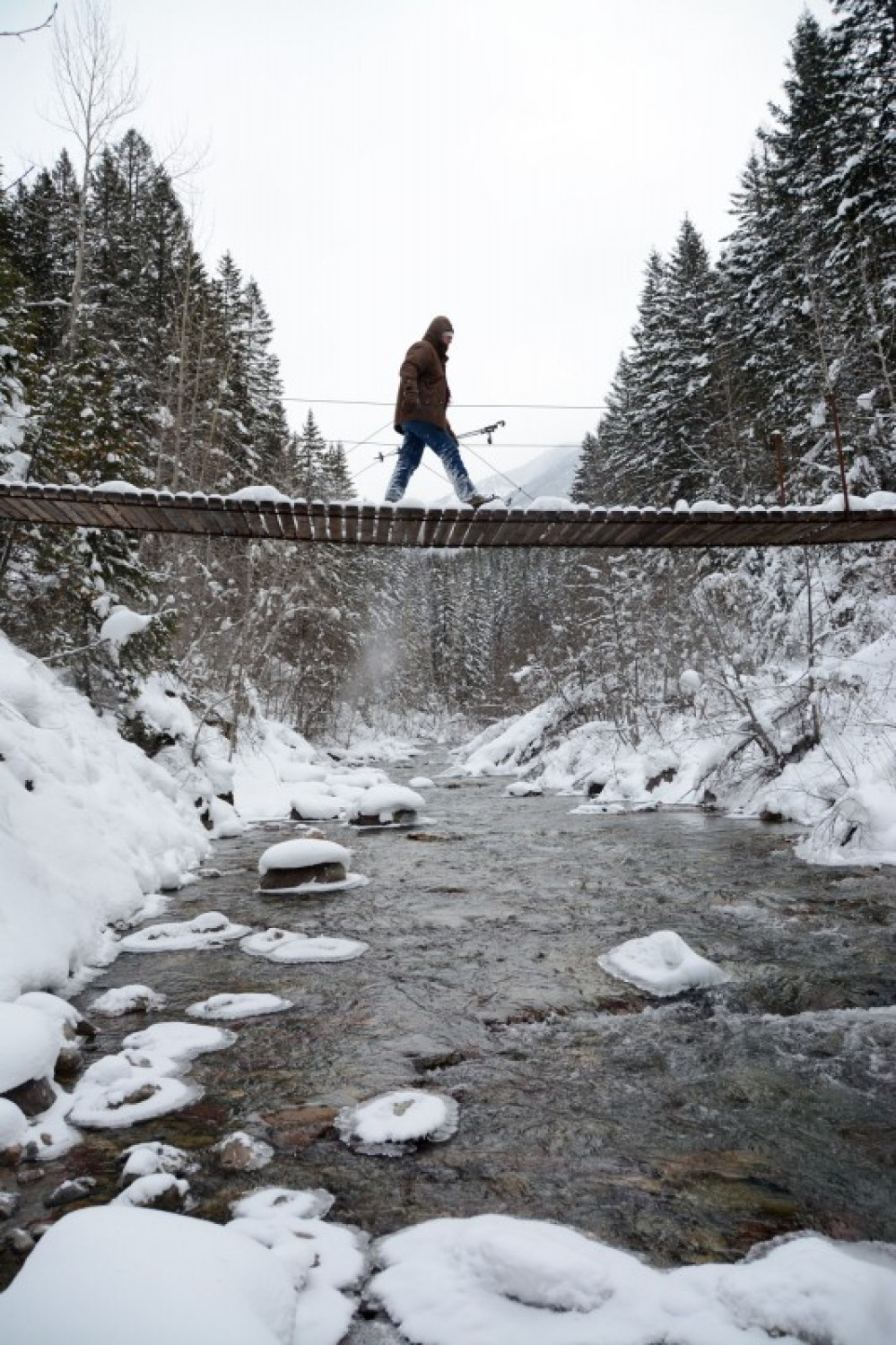 Crossing the suspension bridge over Ole Creek on a tour from Walton Ranger Station. – Devin Schmit
