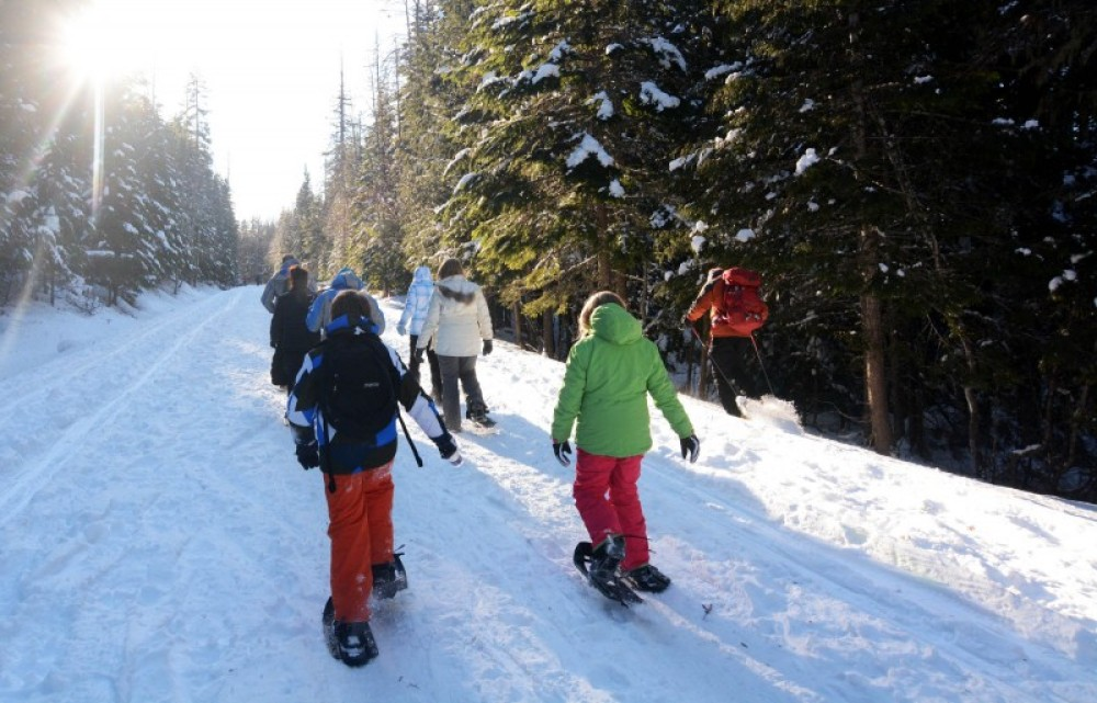 On the home stretch after a chilly snowshoe tour in January. – Devin Schmit