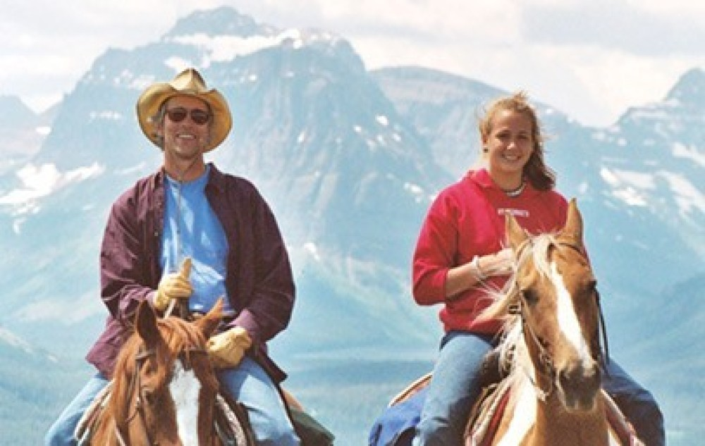 Two Riders with Mountains in Background – Bar W Ranch on Spencer Lake