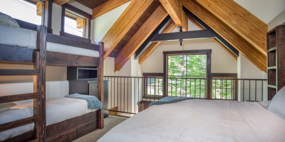 The loft bedroom sleeps 4 in a cozy king bed and 2 twin bunkbeds. – Trevon Baker