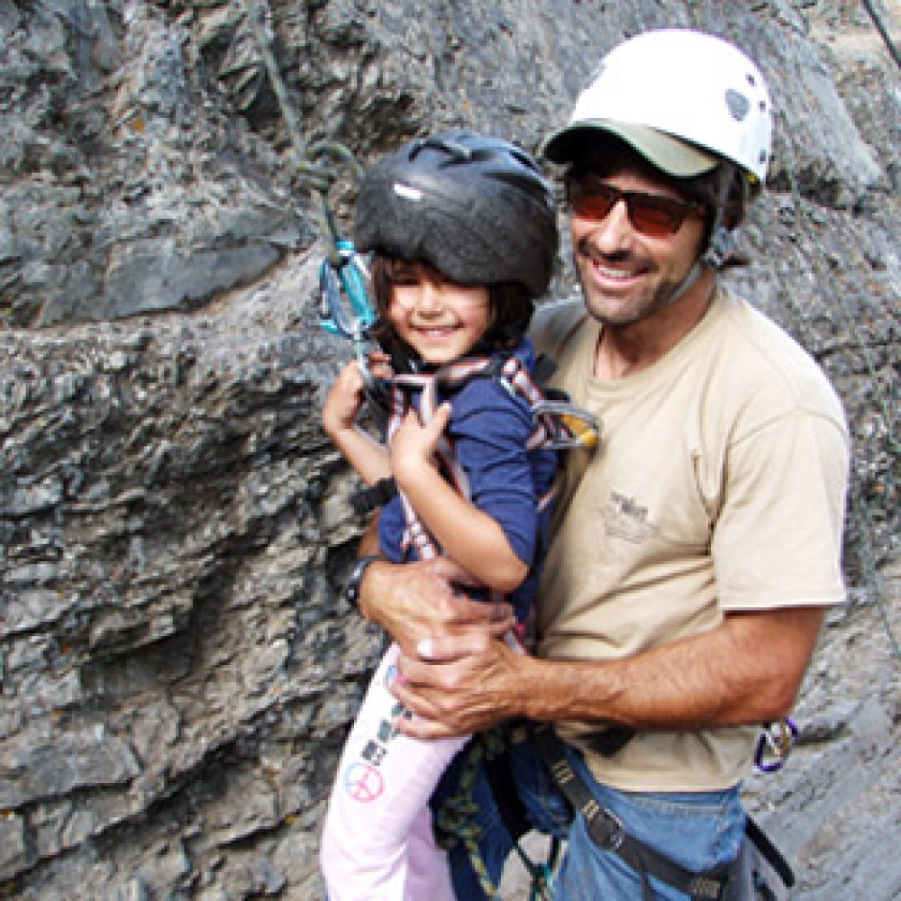 This 4-year old gets an early start to her rock climbing career..