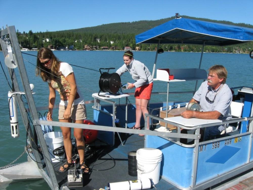 Summer interns prepare scientific equipment for a sampling trip on Whitefish Lake. – Mike Koopal