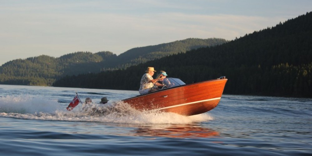 Catching a wave on the Friday evening cruise in a 1958 Chris Craft Continental. – Tim Salt